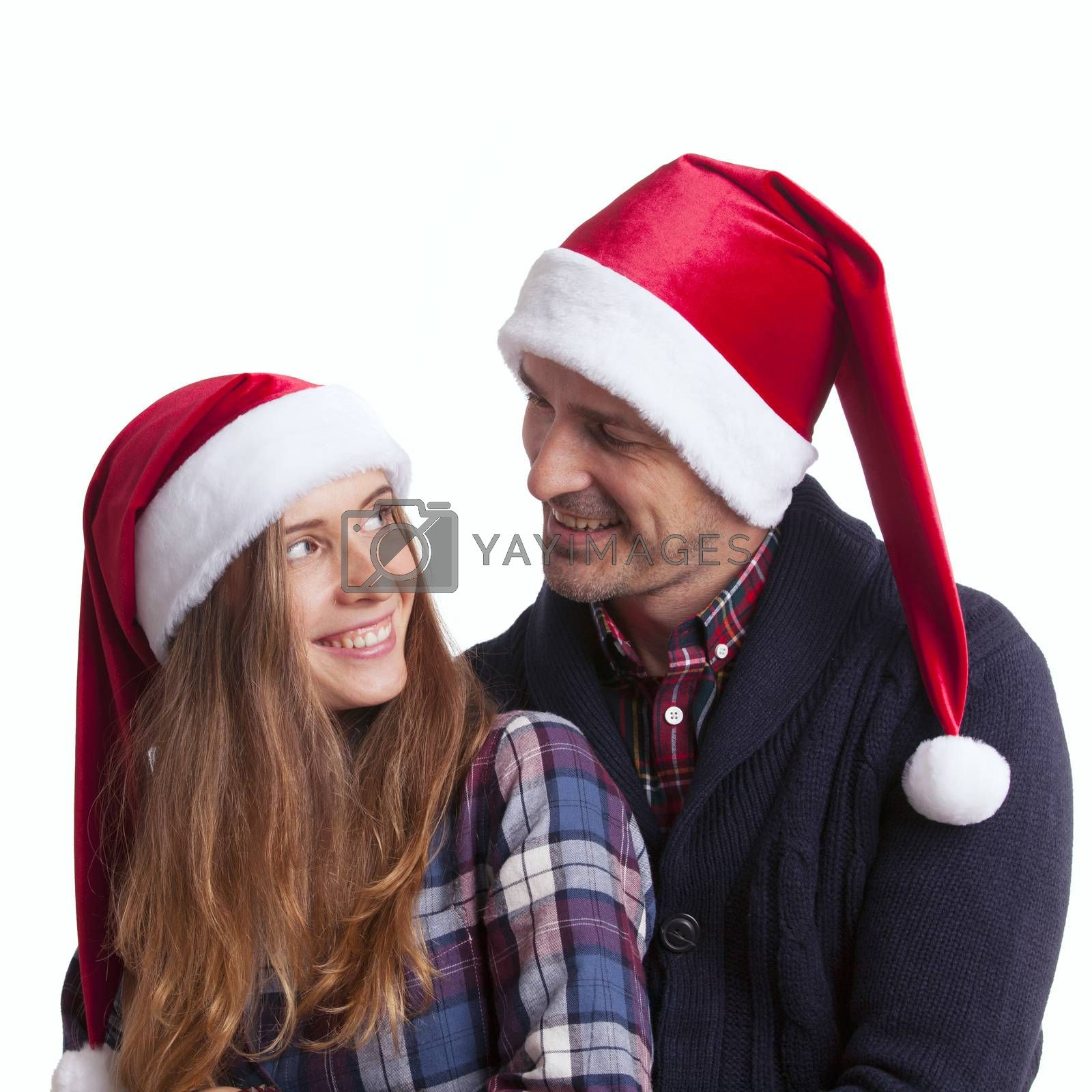 Happy beautiful couple in Santa hats, winter holidays Christmas New Year concept, isolated on white background
