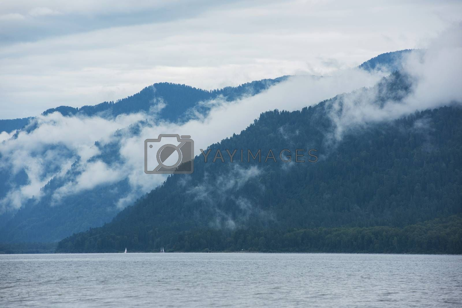 Foggy Teletskoye lake in Altai mountains by rusak