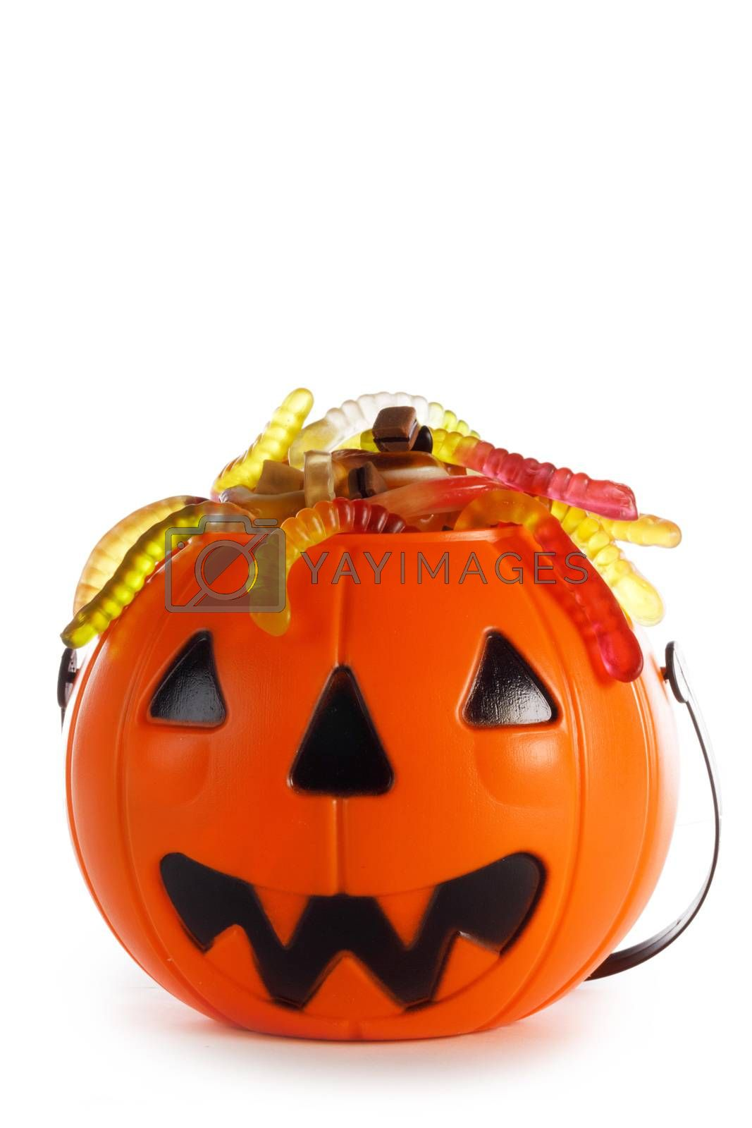 Halloween candies in Jack-O-Lantern bag isolated on white background