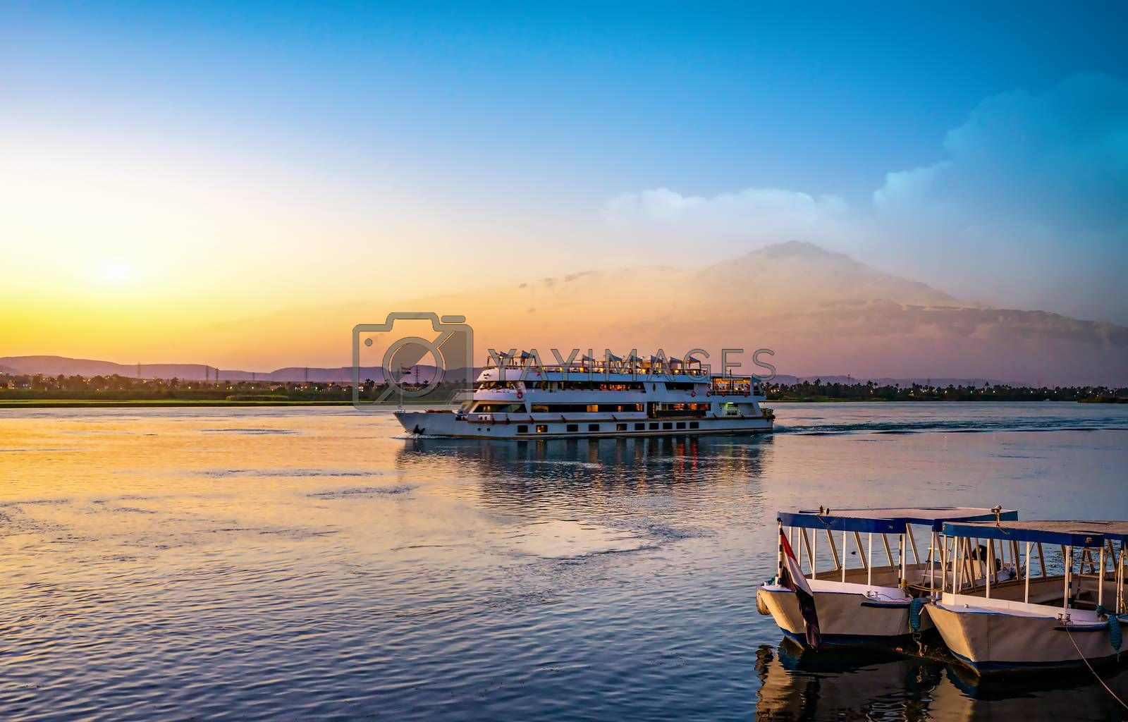 River Nile and ship at sunset in Aswan