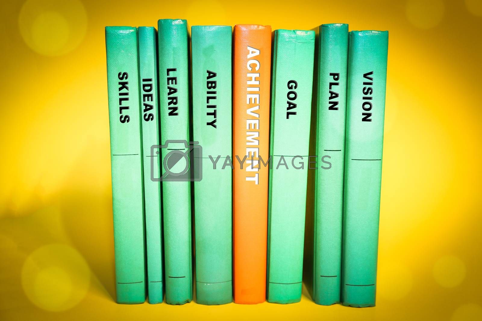 Royalty free image of Achievement concept on books spine, various keywords  by inspireme