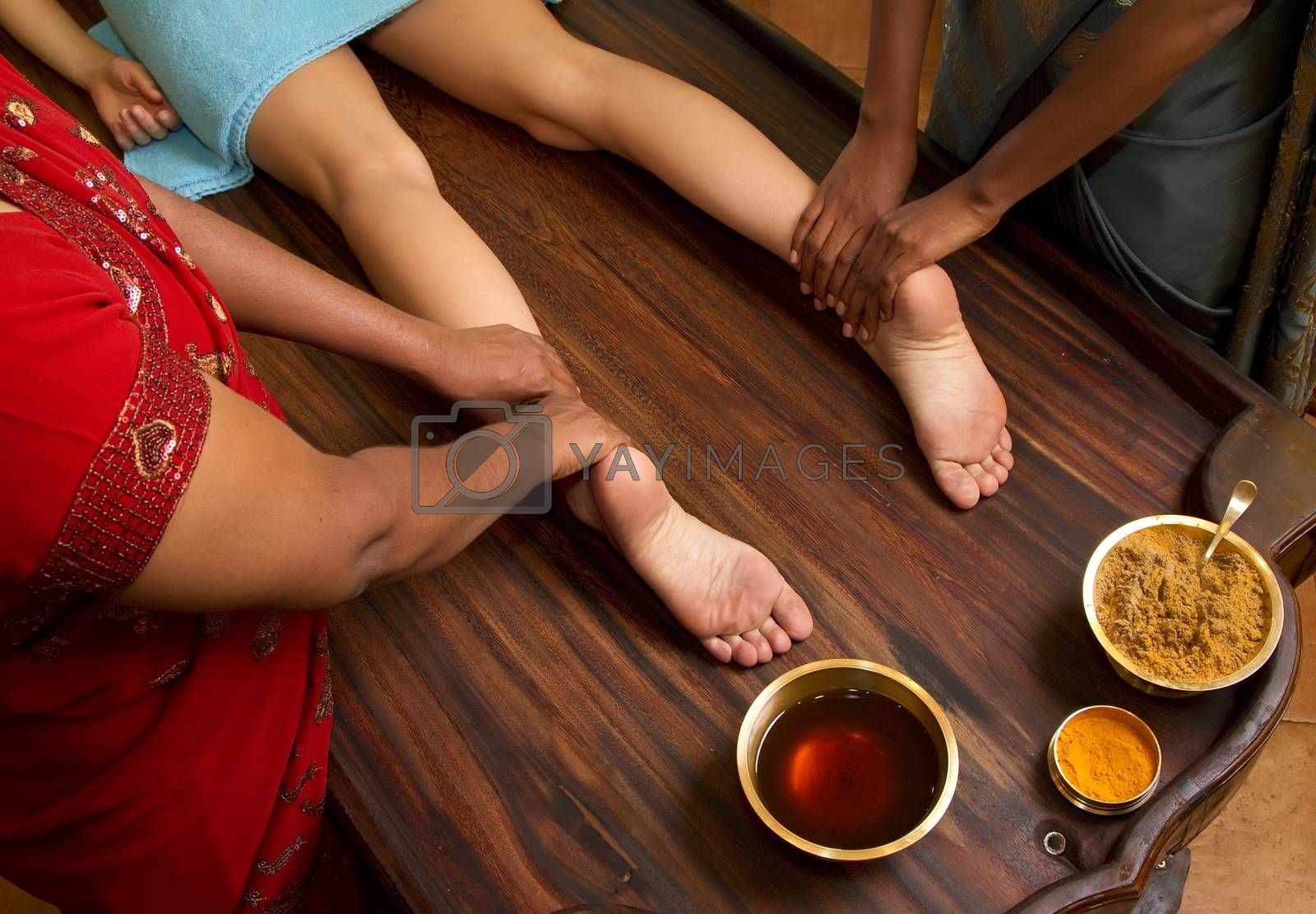 Royalty free image of traditional indian ayurvedic oil foot massage by phortcach