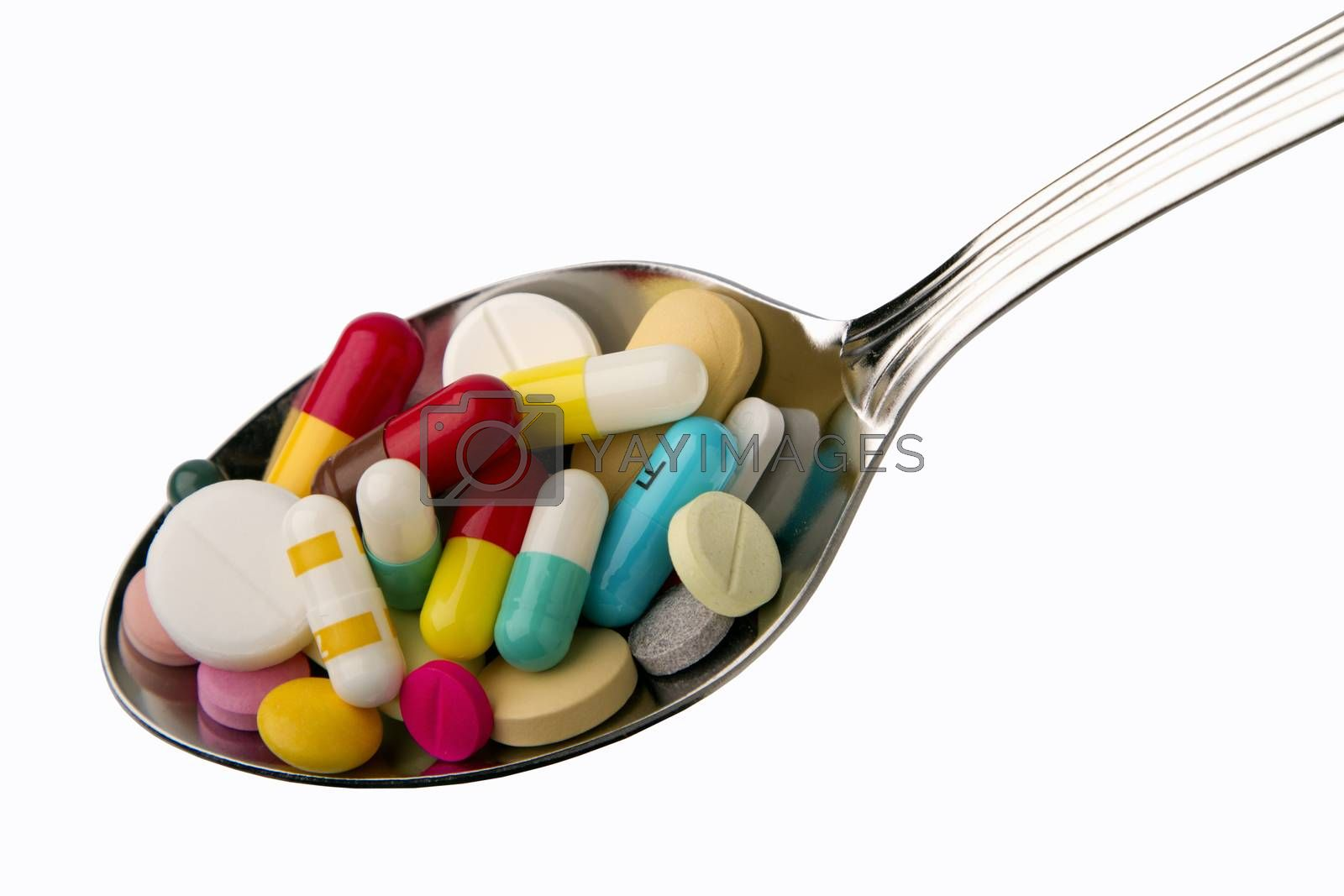 Royalty free image of spoon full of tablets  by phortcach