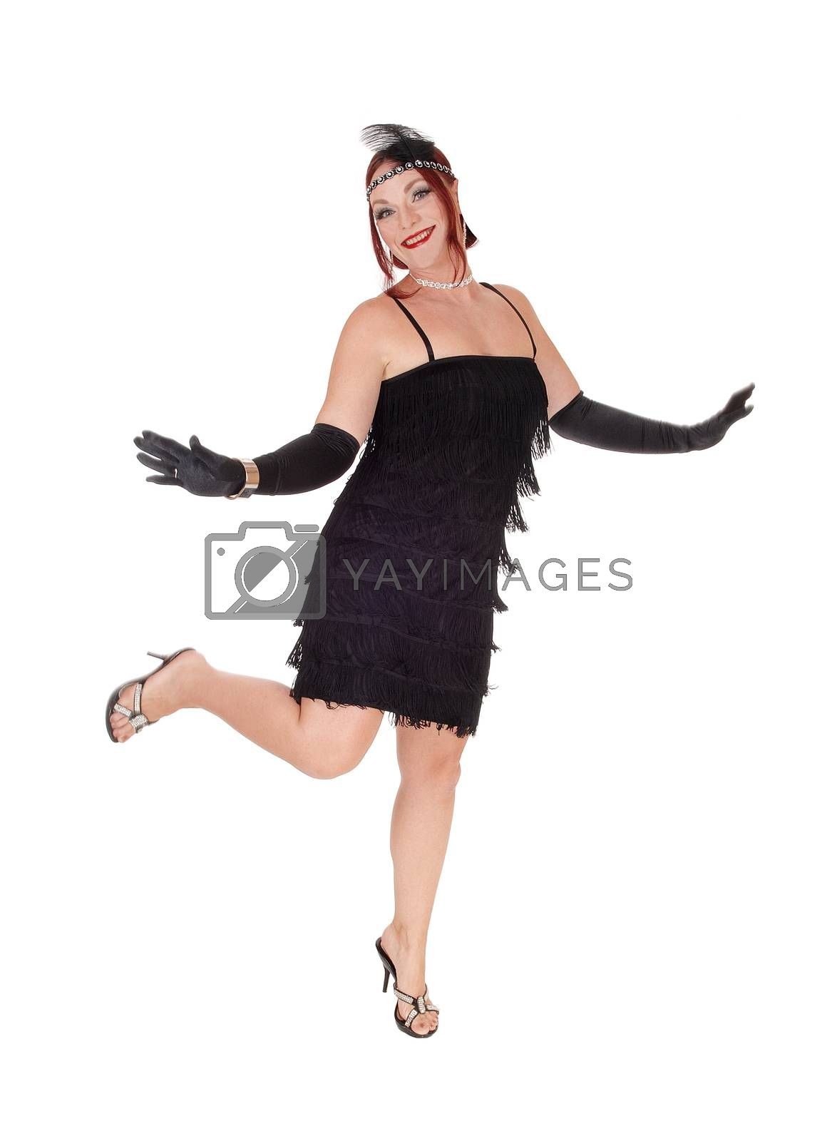 Royalty free image of Woman dancing in a black dress by feierabend