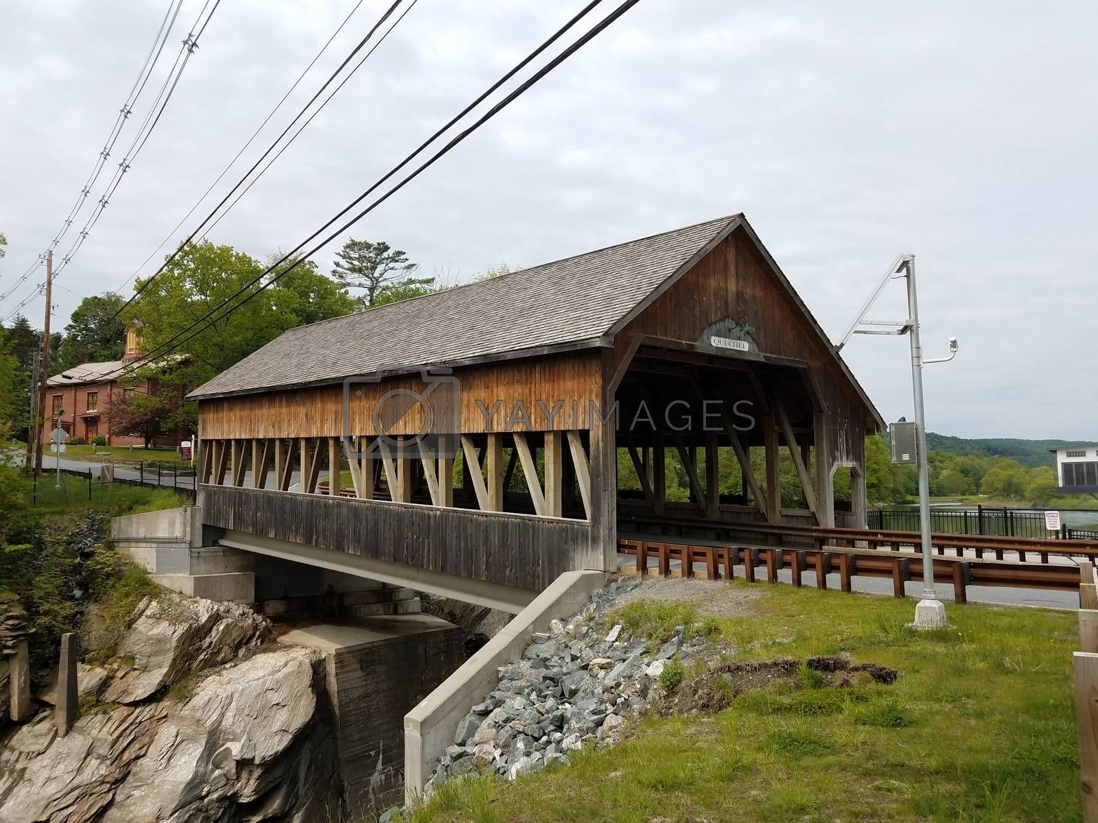 Royalty free image of covered bridge in Quechee, Vermont with wooden covering by stockphotofan1