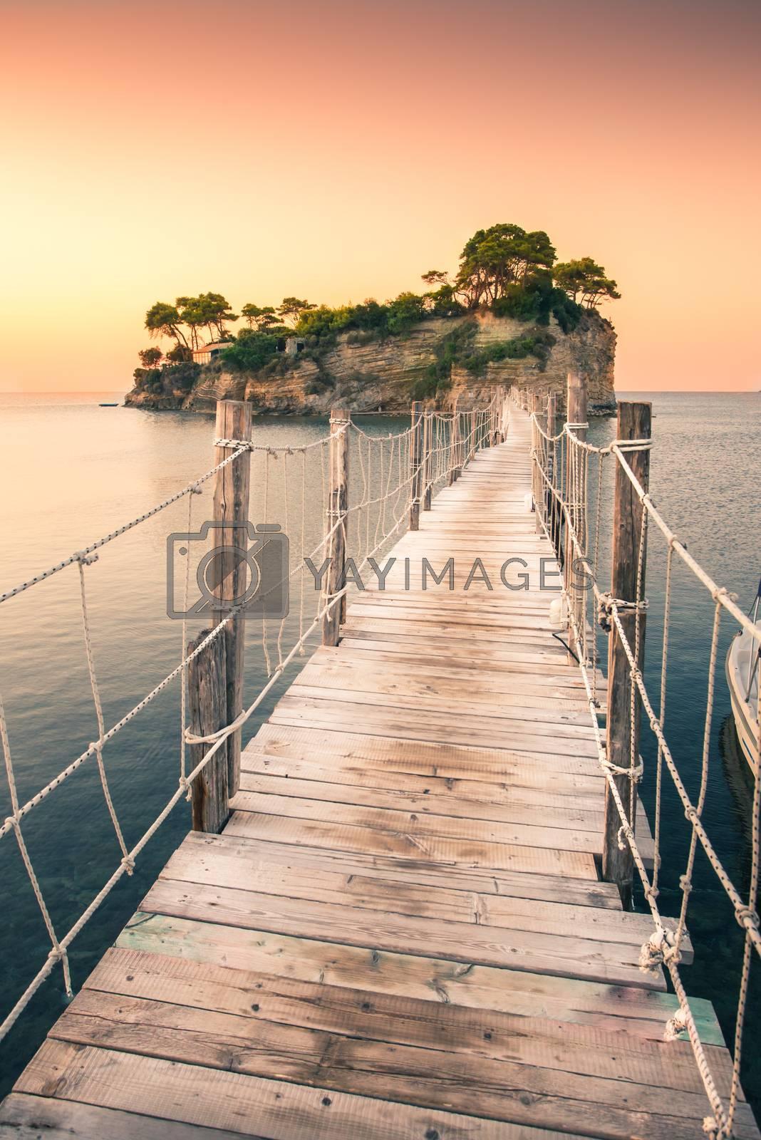 Royalty free image of The sunrise at Agios Sostis Island, Cameo Island in Zakynthos, Greece. Wooden bridge. by petrsvoboda91