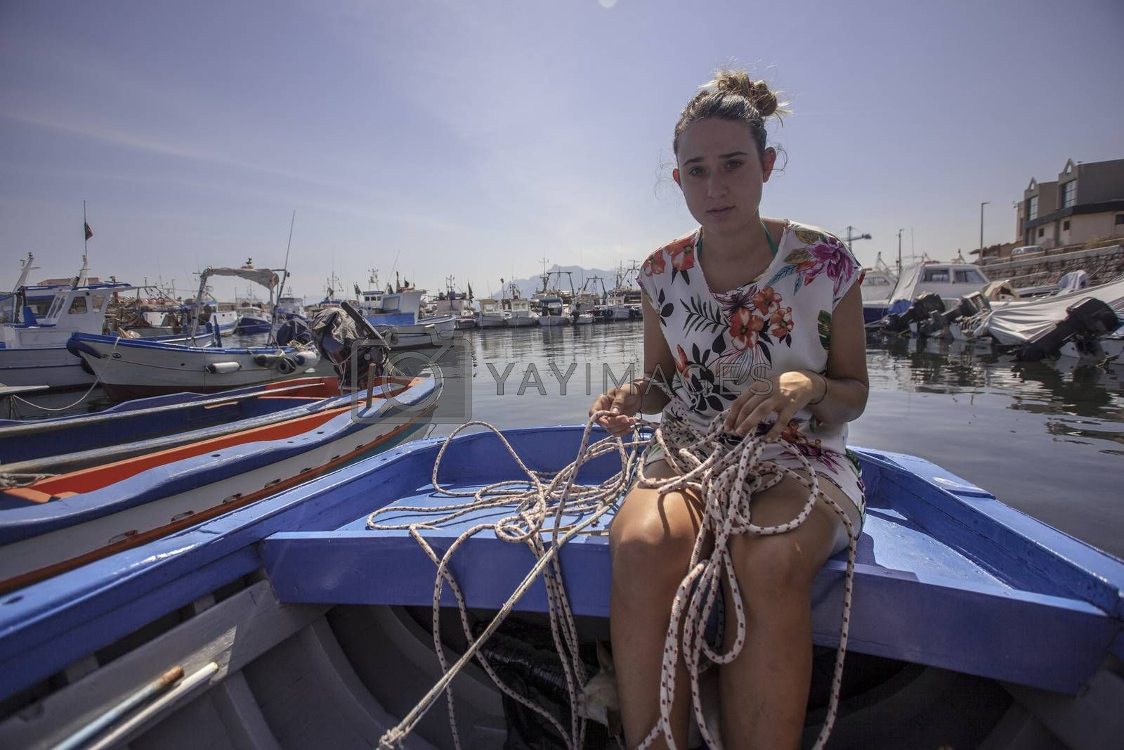 Royalty free image of Girl with ropes in the boat #2 by pippocarlot