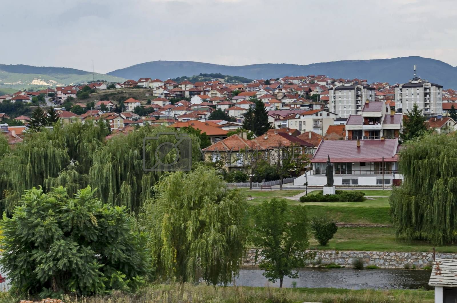 Royalty free image of Landscape of Residential district and river valley Bregalnica with place for relax and trees, town Delchevo among Maleshevo and Osogovo mountains by vili45
