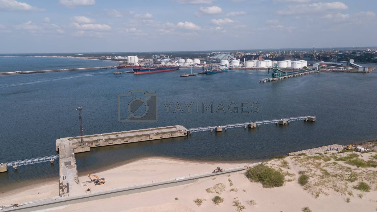 Harbor Ventspils Latvia Aerial view of countryside drone top view by desant7474