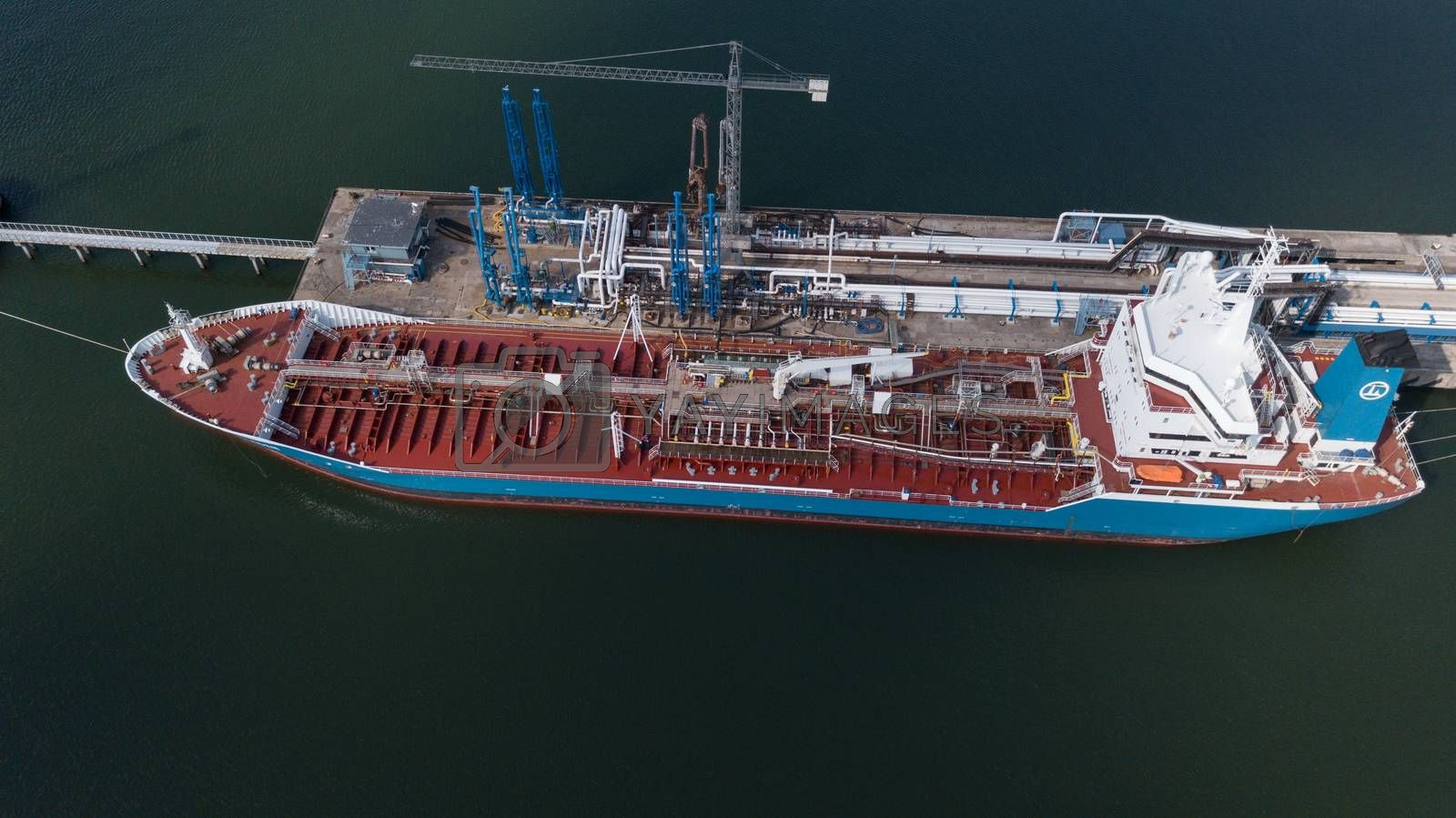 Royalty free image of ship going in to Harbor Ventspils Latvia Aerial view of countryside drone top view by desant7474