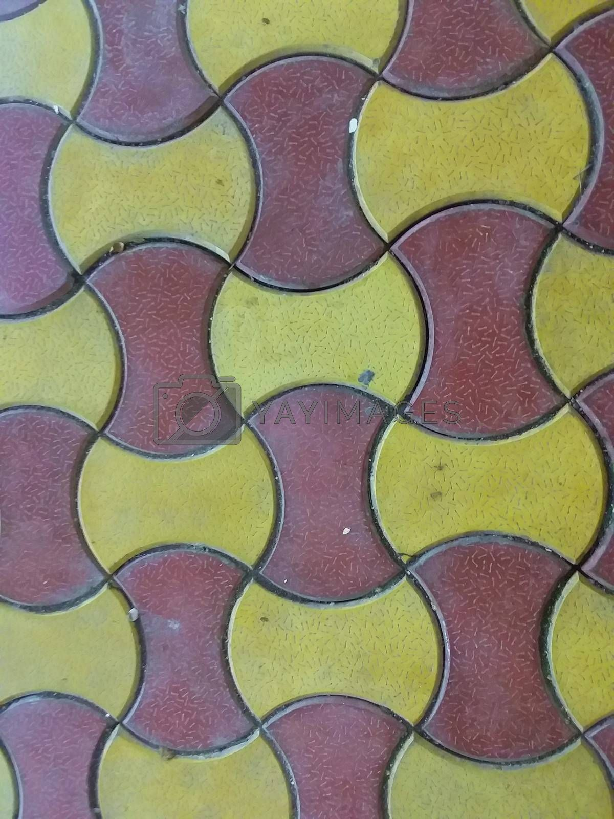 Royalty free image of red and yellow ceramic design on tiles by gswagh71