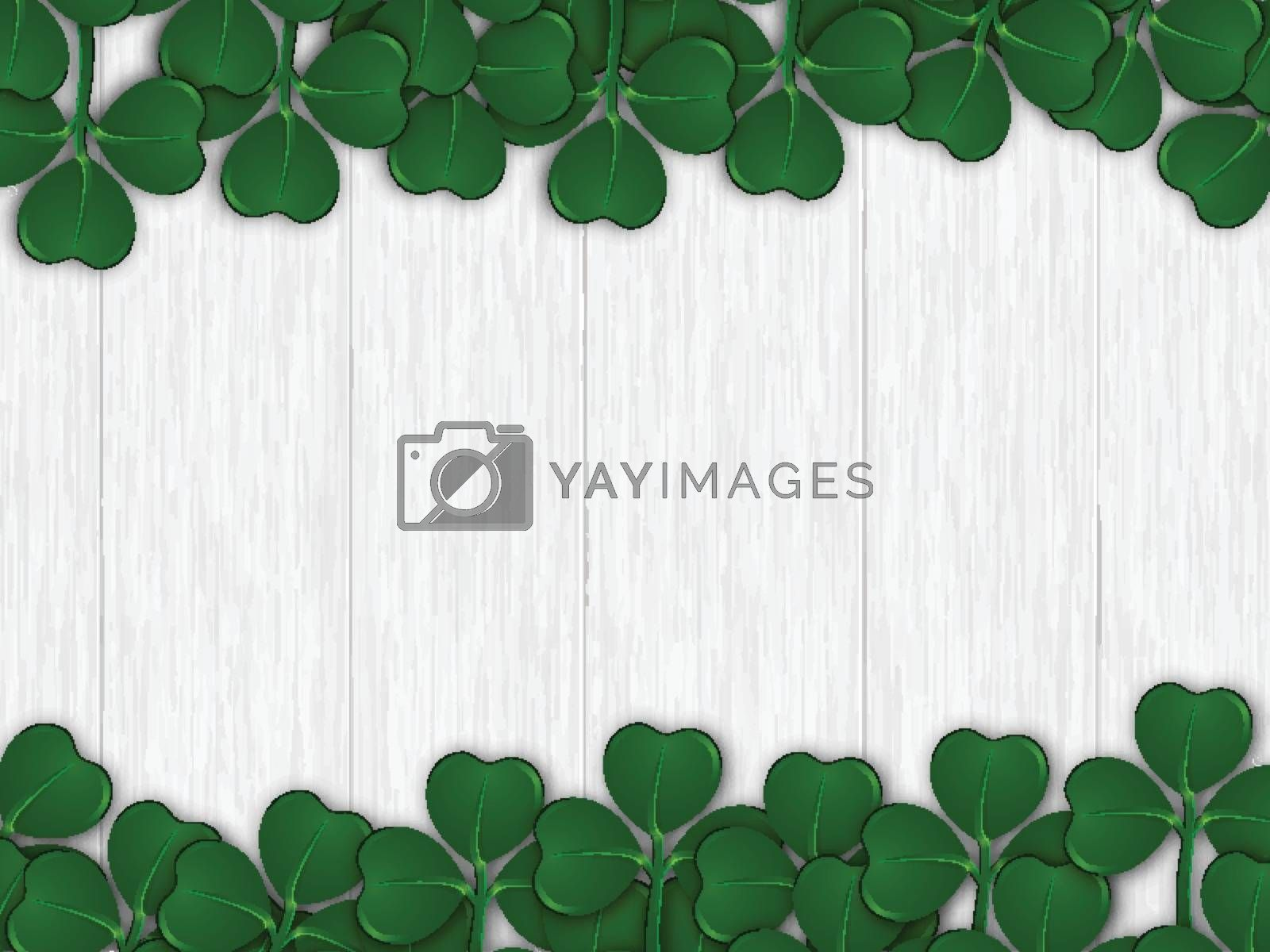 Green shamrock leaves decorated on wooden texture background for by aispl