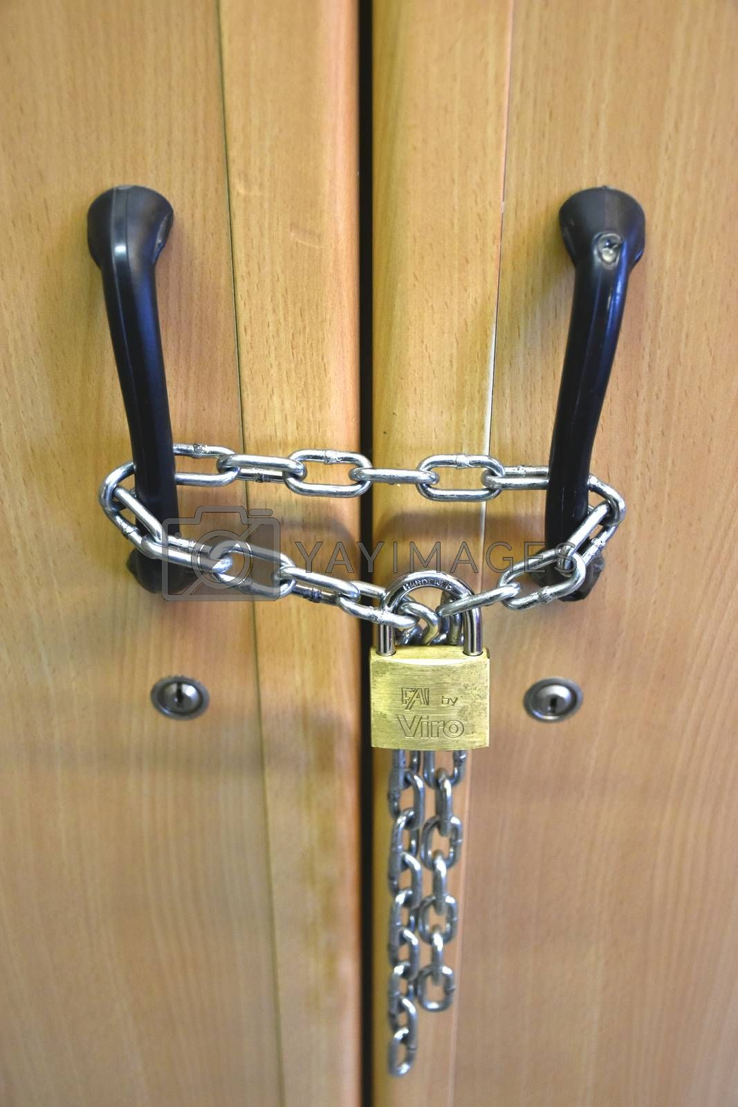 The photo represents a lock that close two doors.
