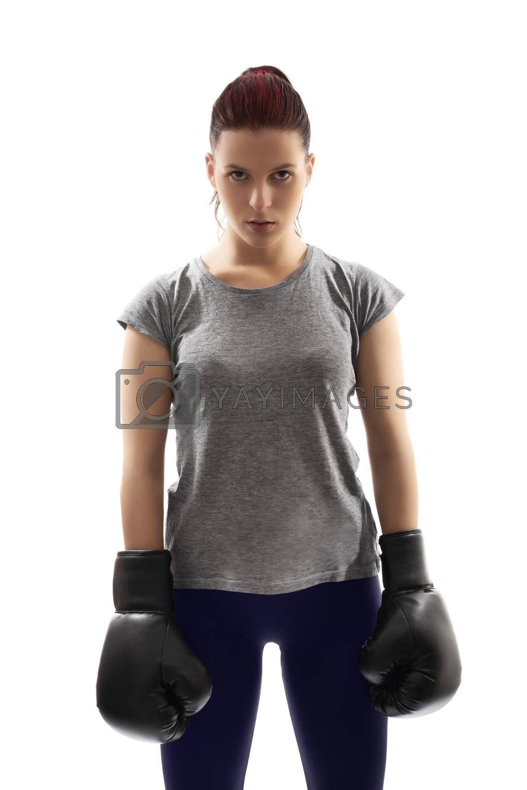 A portrait of a beautiful young girl with boxing gloves under harsh lightning, isolated on white background.