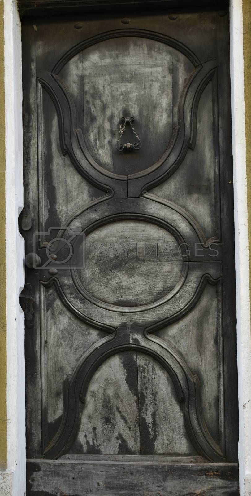 A view of an ancient door color silver, typical in old houses in Piedmont.