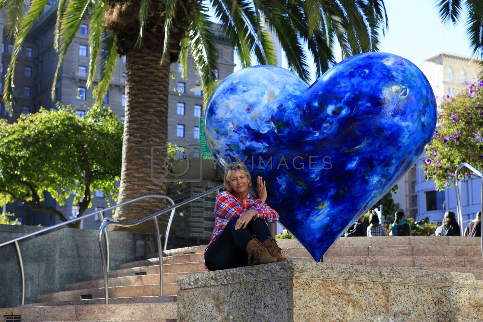 Tourist on Union Square Park in San Francisco with Hart on Display