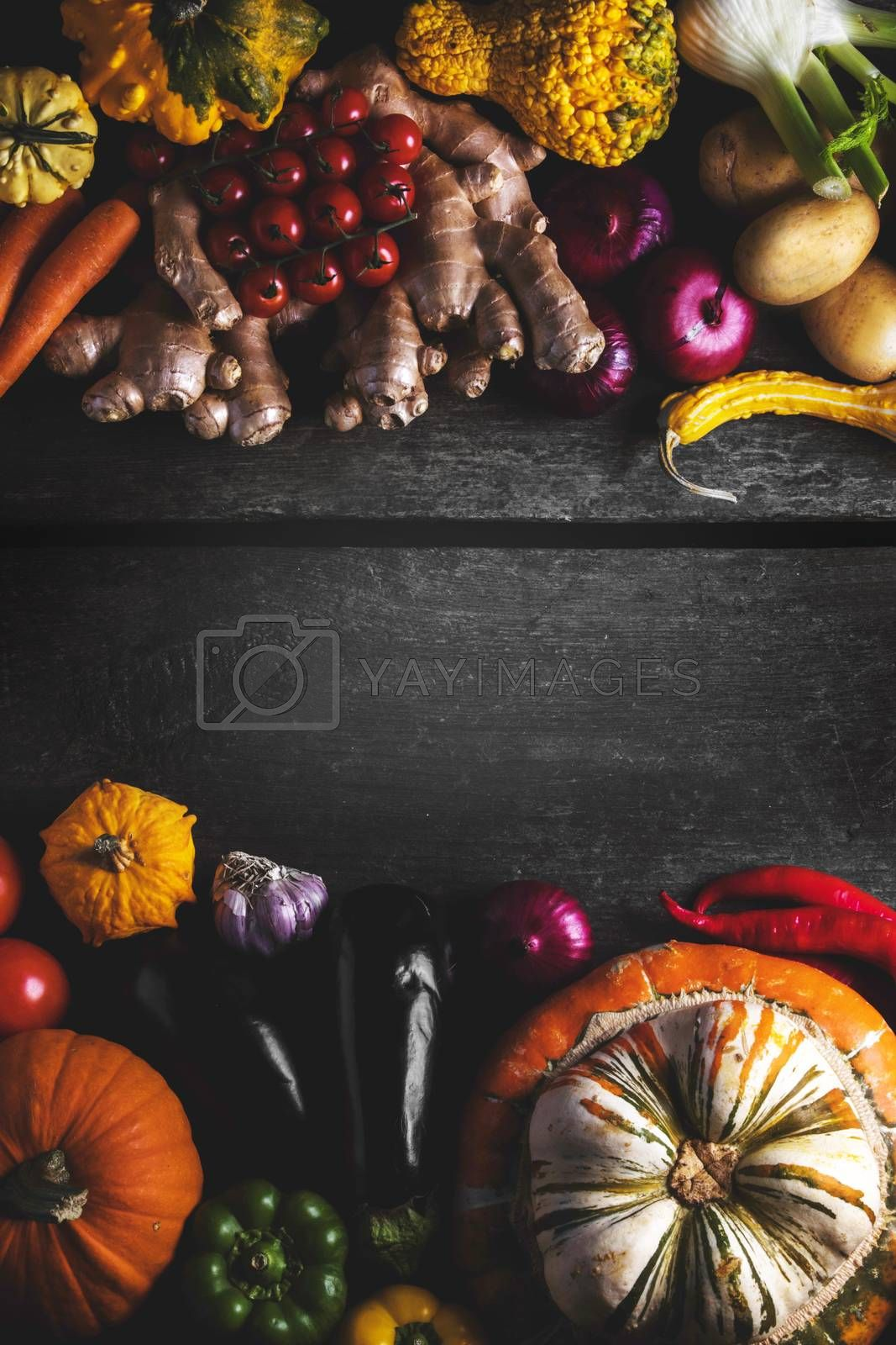 Harvest of many vegetables on rustic wooden table background border frame with copy space for text