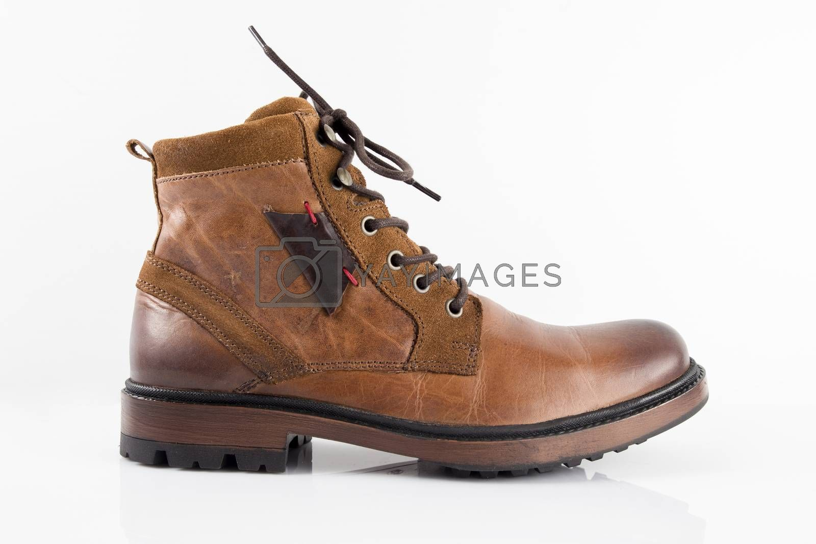 Brown leather boots on white background, isolated product, top view.