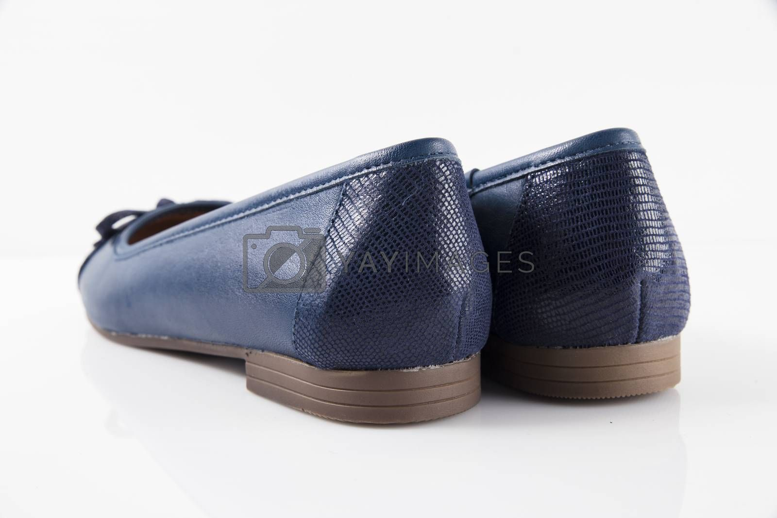 Pair of blue leather shoes on white background, isolated product, top view.