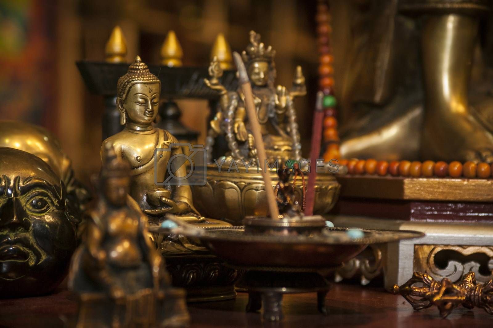 Oriental culture: Set of statues of Buddha and many other symbols of oriental culture in a beautiful bright and complete picture.