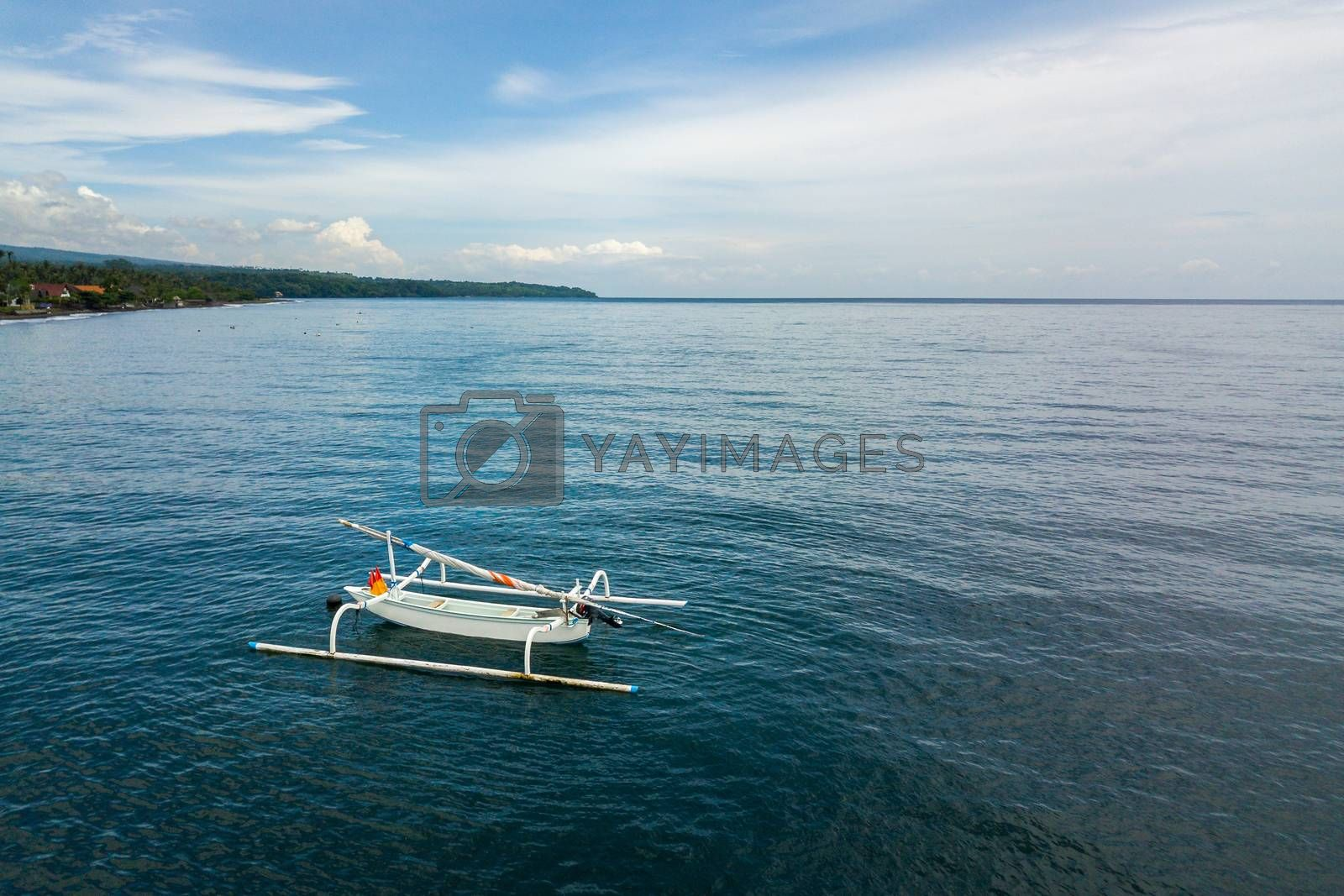 Aerial view of a traditional fishing boat called jukung in Bali, Indonesia.