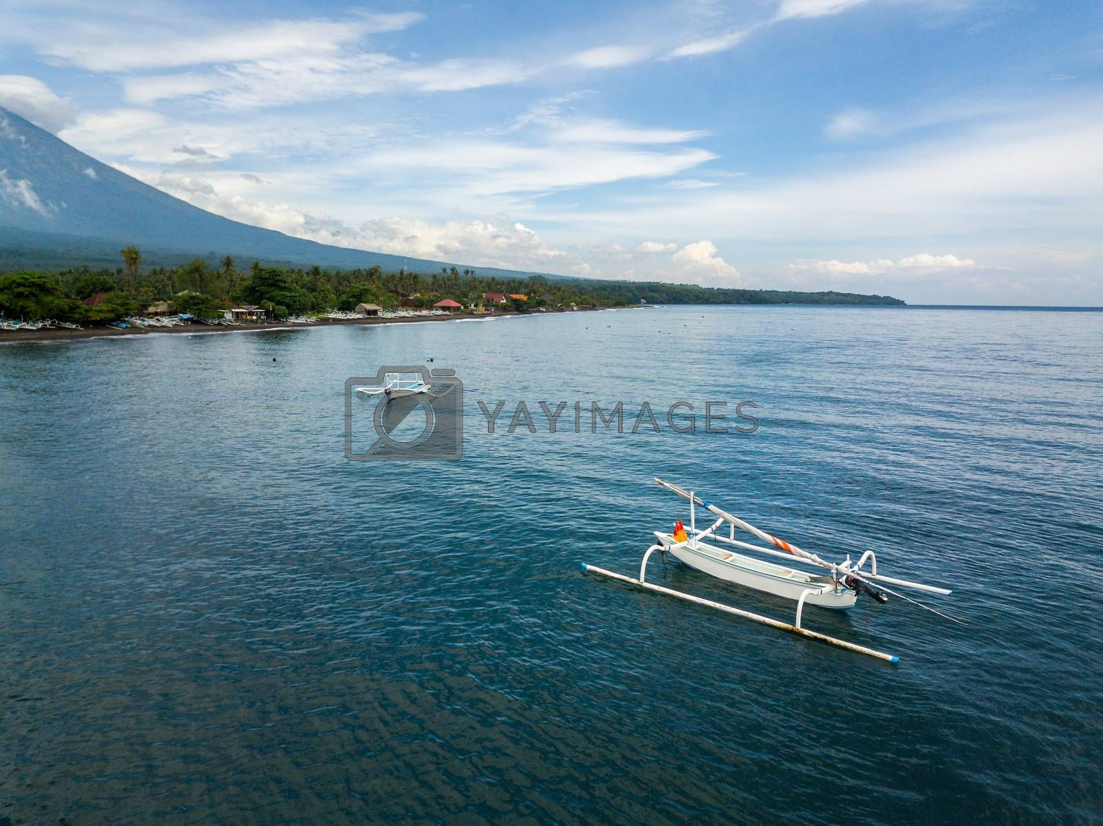 Aerial view of traditional fishing boats called jukung in Bali, Indonesia.