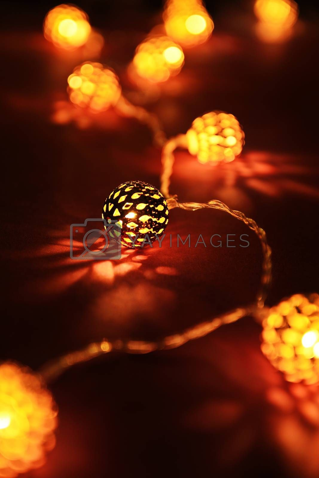 Close up shot of golden blurred Christmas lights making cozy and romantic atmosphere. Festive background with blurry lights.
