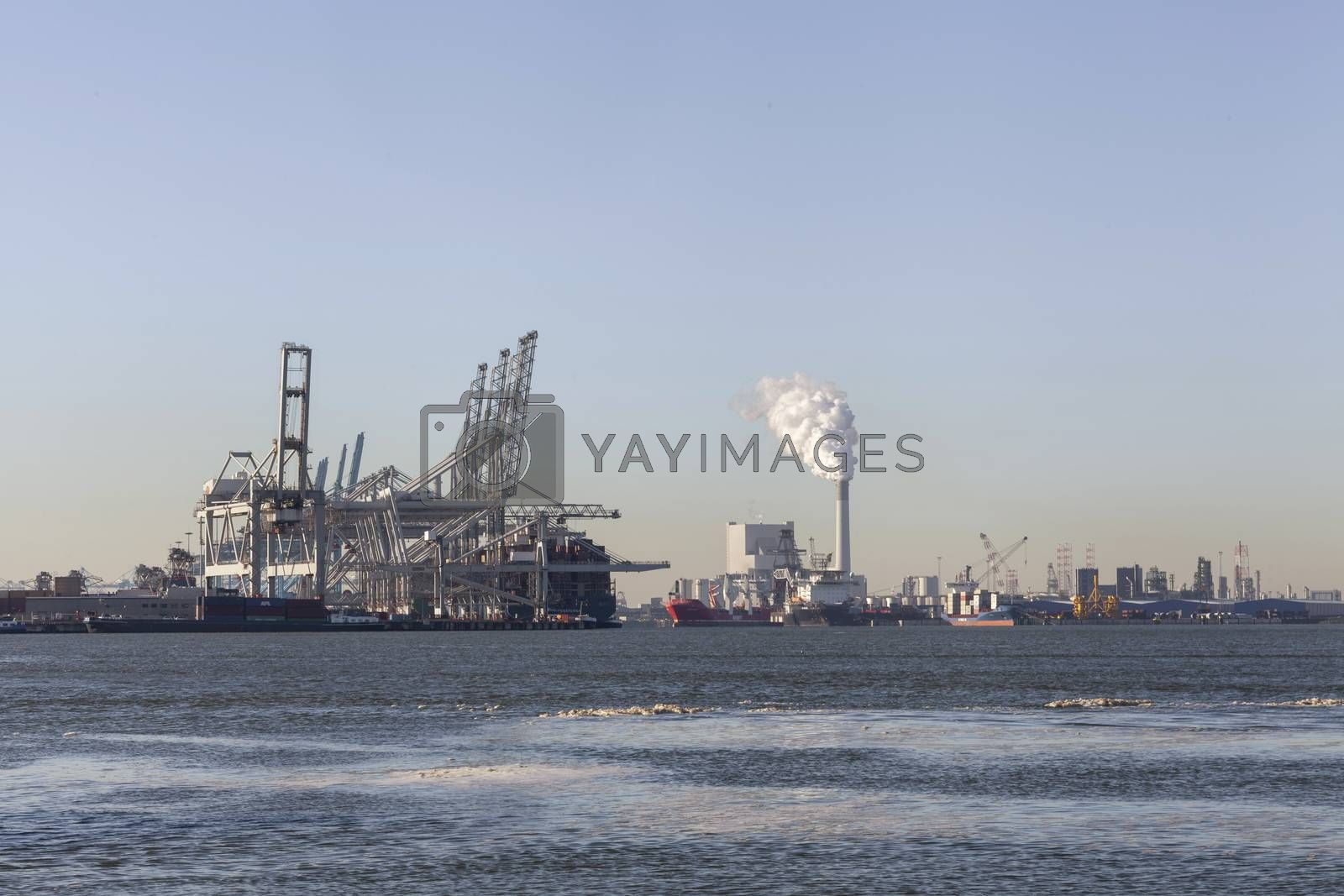 shipping container terminal at dusk, modern harbor and global trade background, Rotterdam