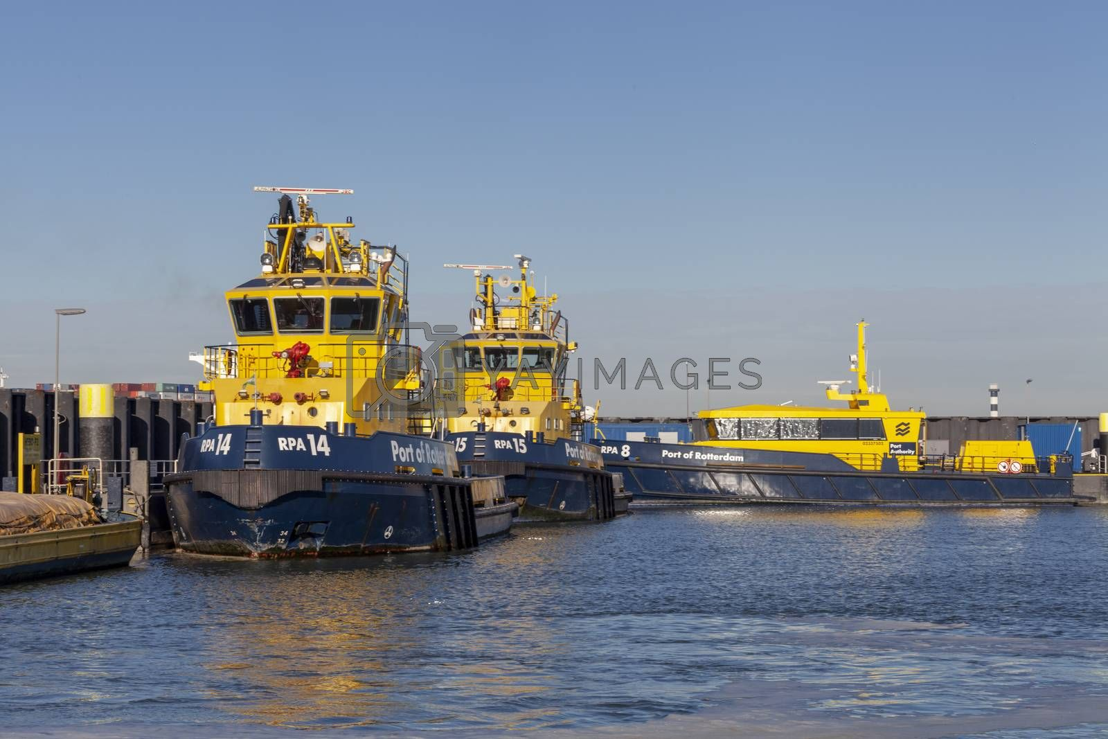 Fire fighting boats of the port of Rotterdam are docked on the side of the maasvlakte near the industrial container port. Rotterdam Netherlands