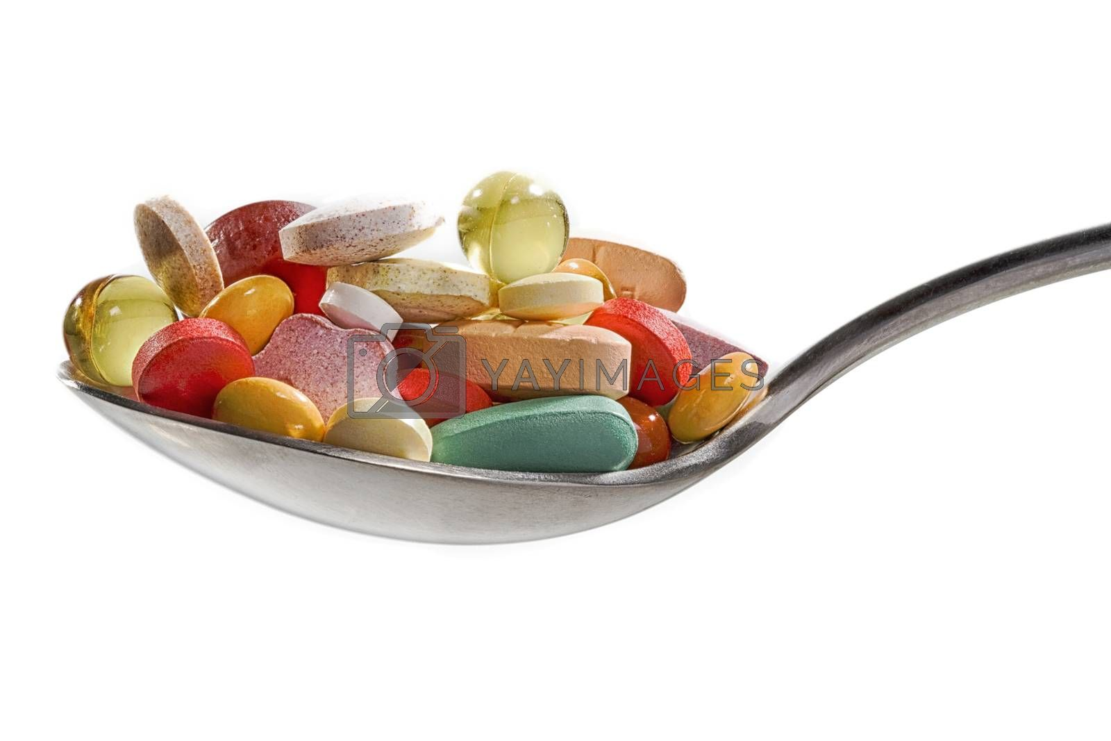 Medicine pills or capsules in a spoon. Drug prescription for treatment medication. Pharmaceutical medicament, cure in container for health. Antibiotic, painkiller closeup