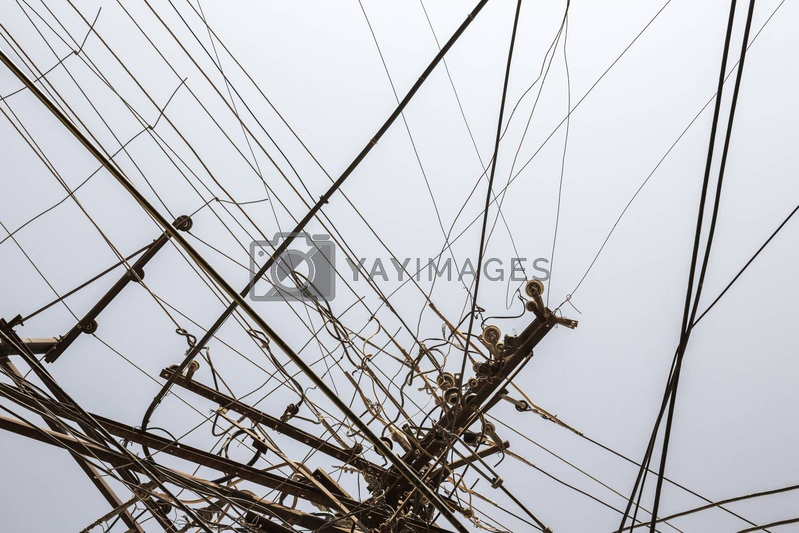 Messy electrical wires isolated on greyblue background