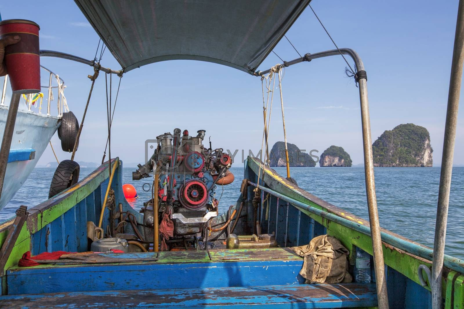 Old Machine of Fishing boat at the sea in Thailand