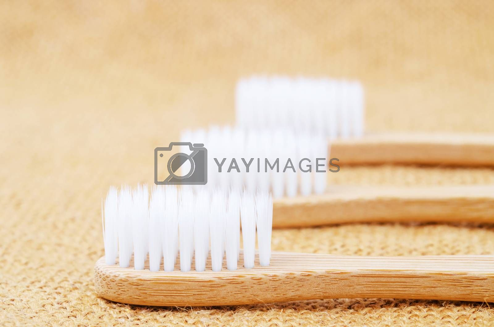 Bamboo toothbrushes on sack backgroud.
