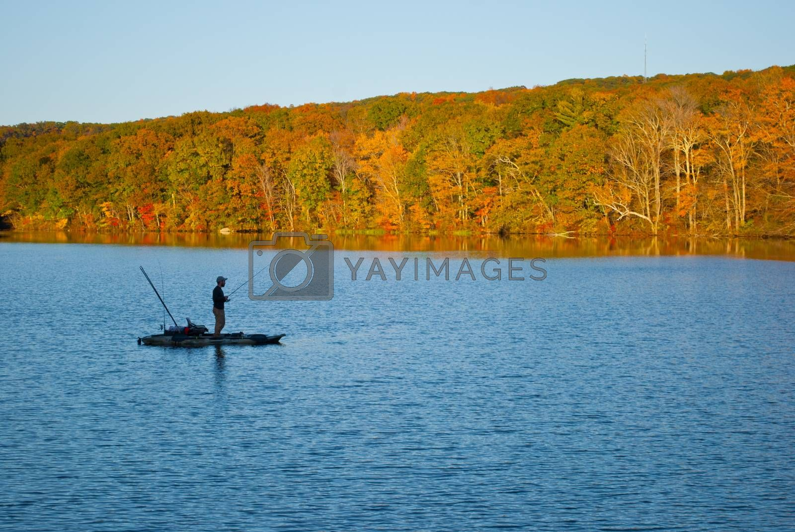 Fishrman in Risley Park Vernon Connecticut during autumn fall with beautfull October foliage