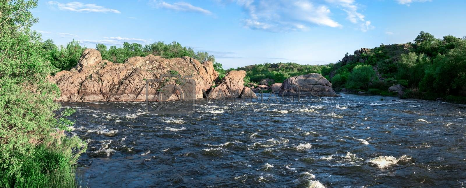 The rocky banks of the Southern Bug River near the village of Migiya in Ukraine on a sunny summer day