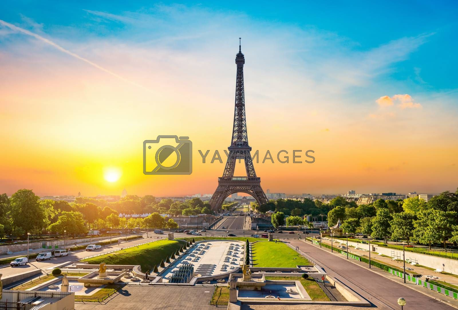 Eiffel Tower and fountains near it at dawn in Paris, France