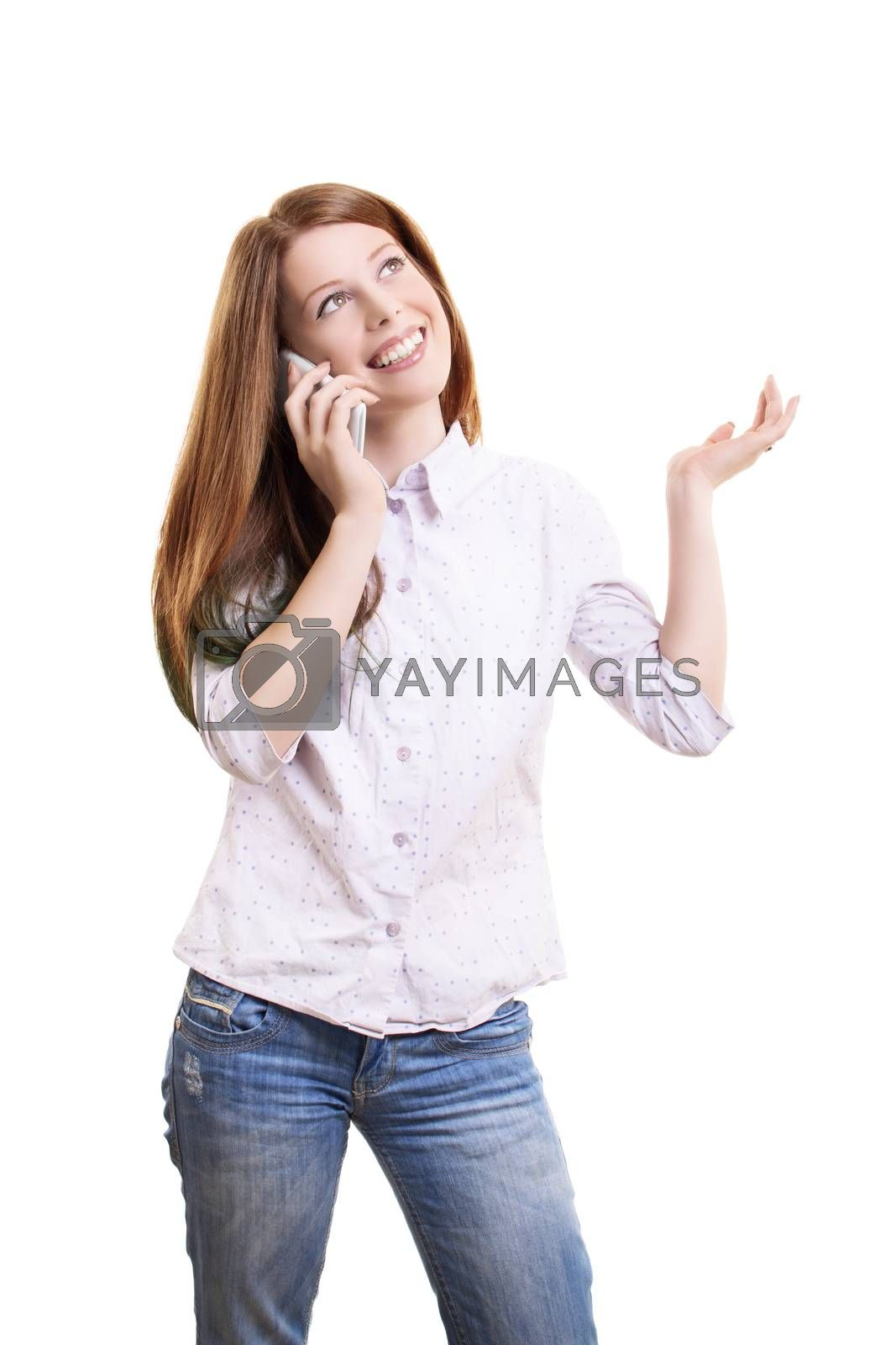 Smiling beautiful young woman in casual clothing talking on a phone and gesturing with one hand, isolated on white background.