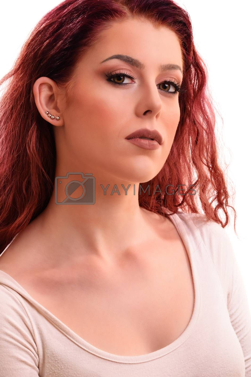 Sensual portrait of a beautiful redhead young woman with soft clean make up, isolated on white background.