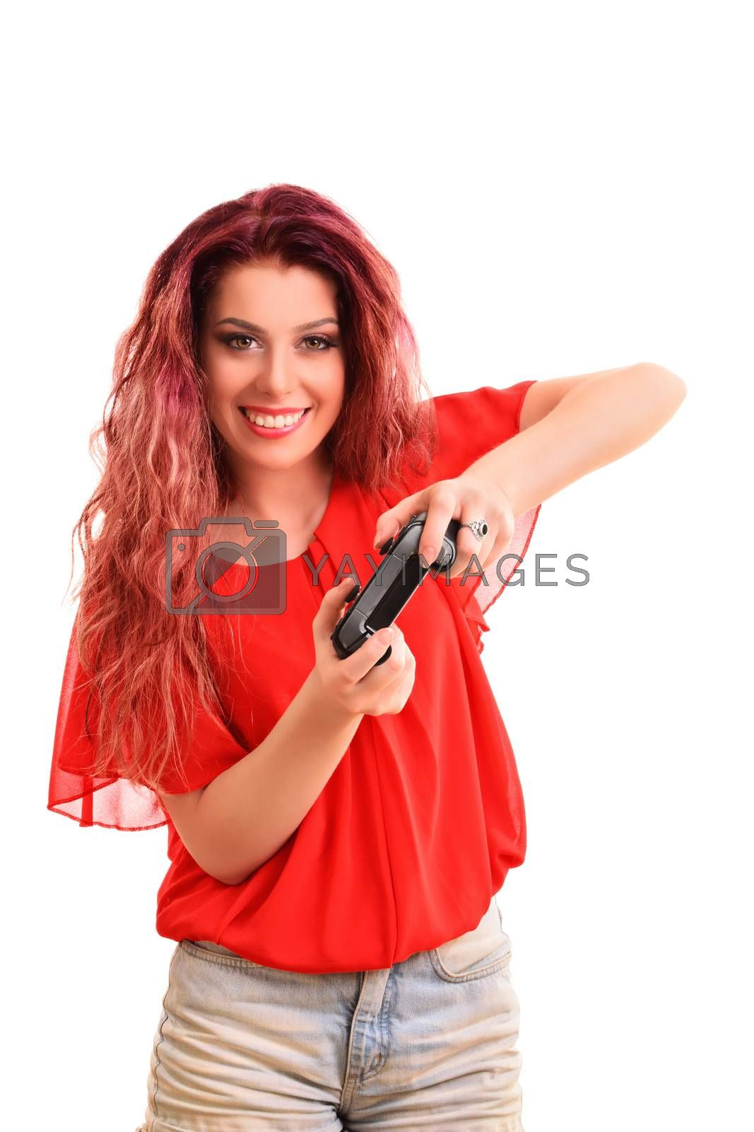Portrait of a beautiful attractive young girl smiling, playing on a game controller, isolated on white background.