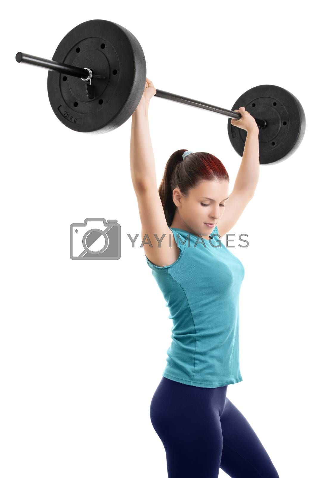 Beautiful young girl holding up a barbell, isolated on white background.