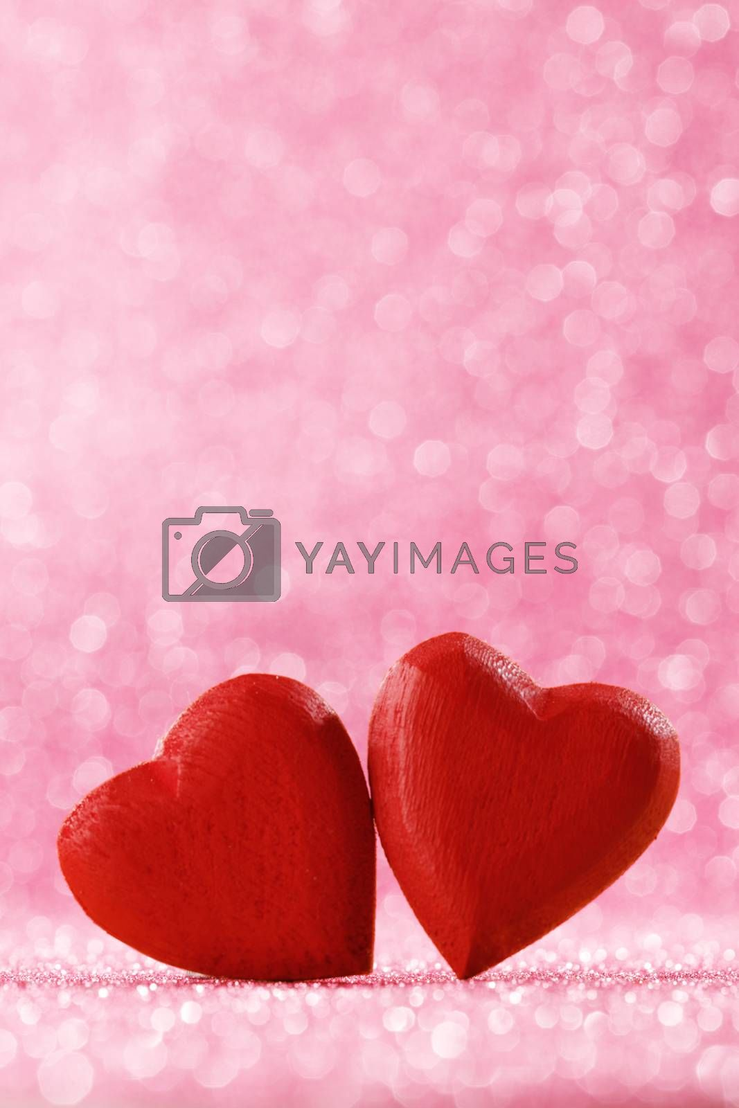 Two handmade wooden red hearts on beautiful bokeh background. Vintage style. Love Valentine's Day concept.