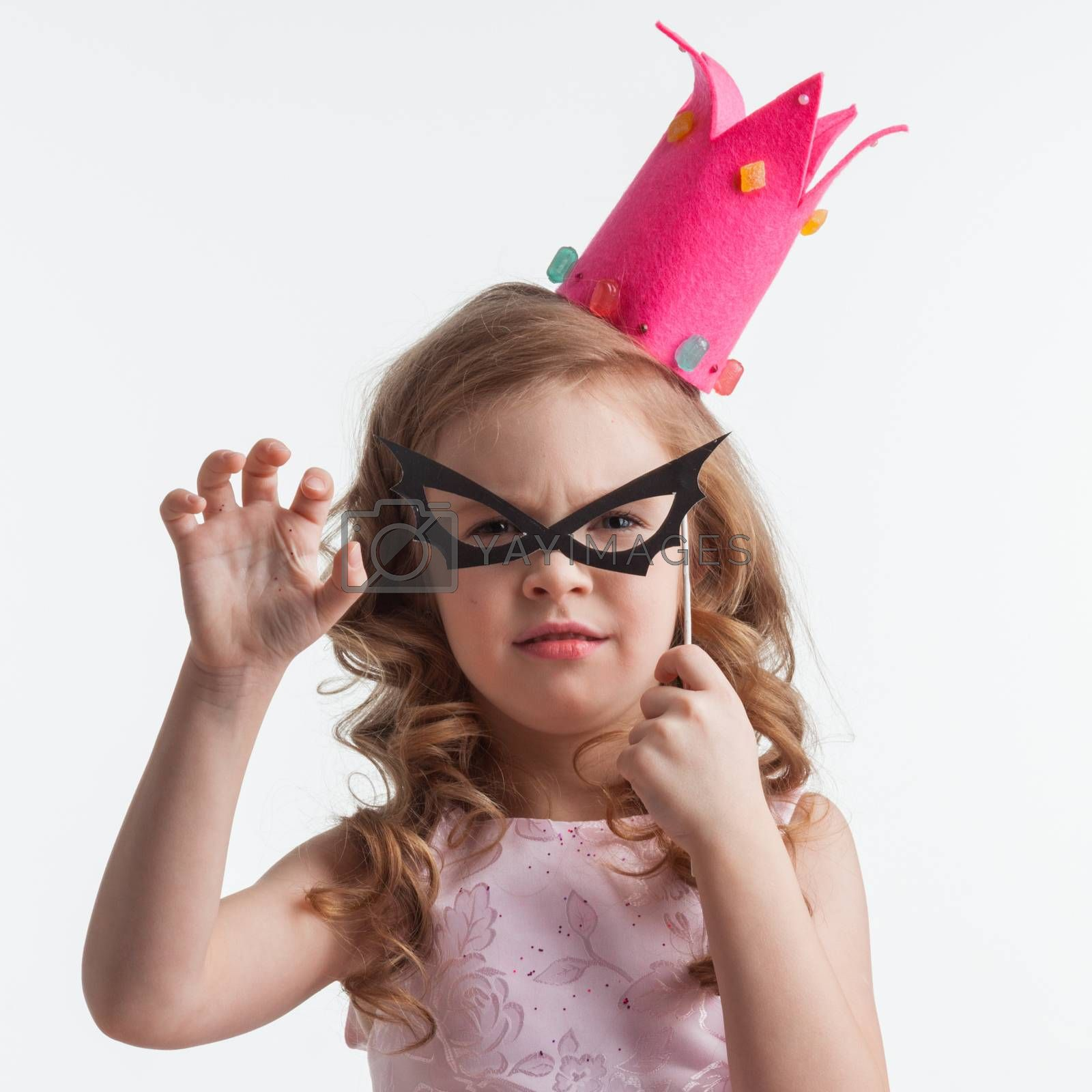 Beautiful little candy princess girl in crown and bat mask, on fake glasses, halloween costume concept