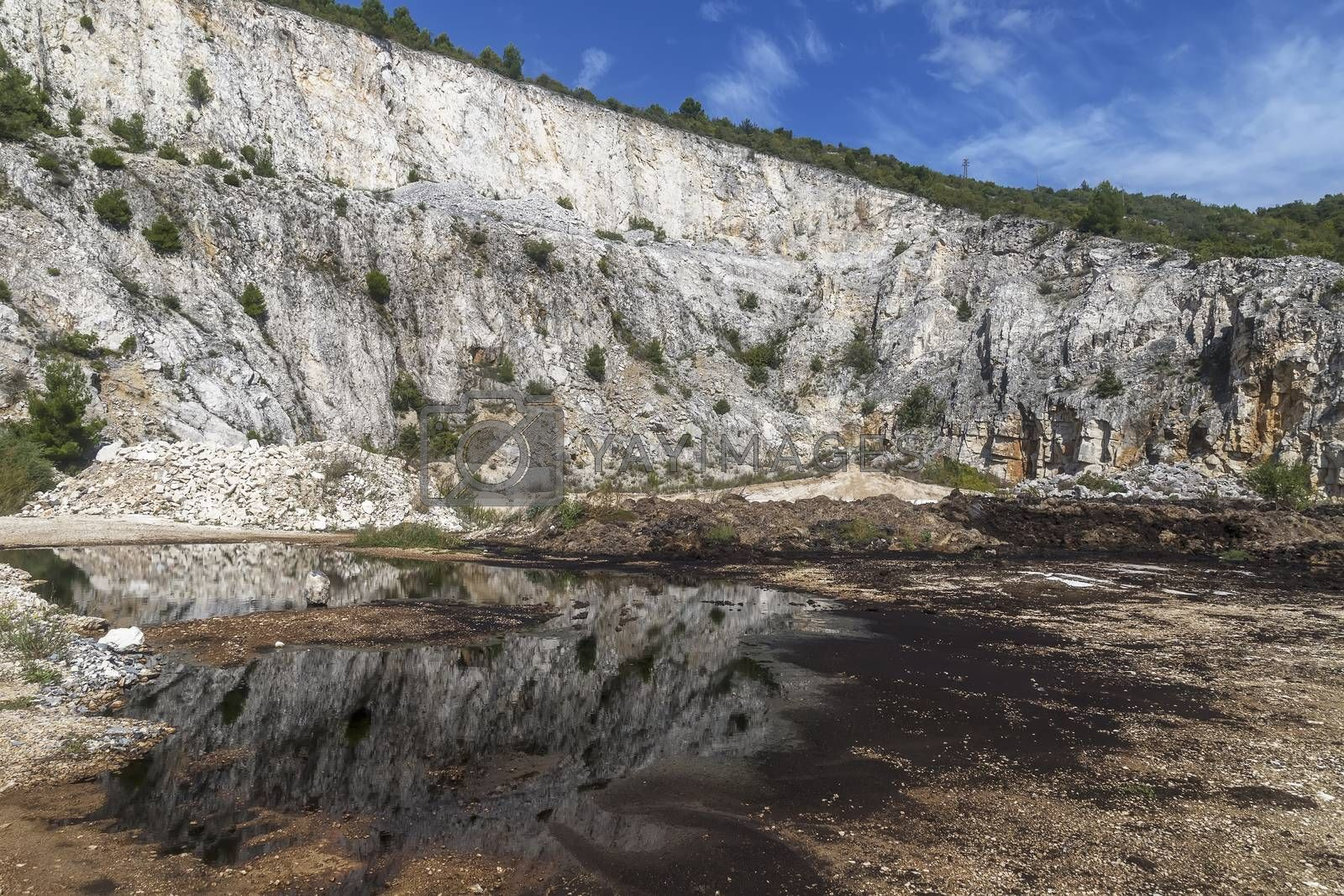 black refelection inside of abandoned quarry