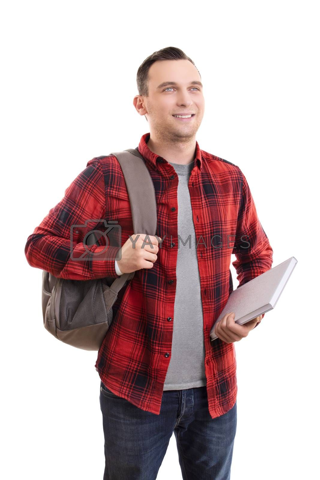 Portrait of a smiling male student in casual clothing, carrying backpack and notebook, isolated on white background.