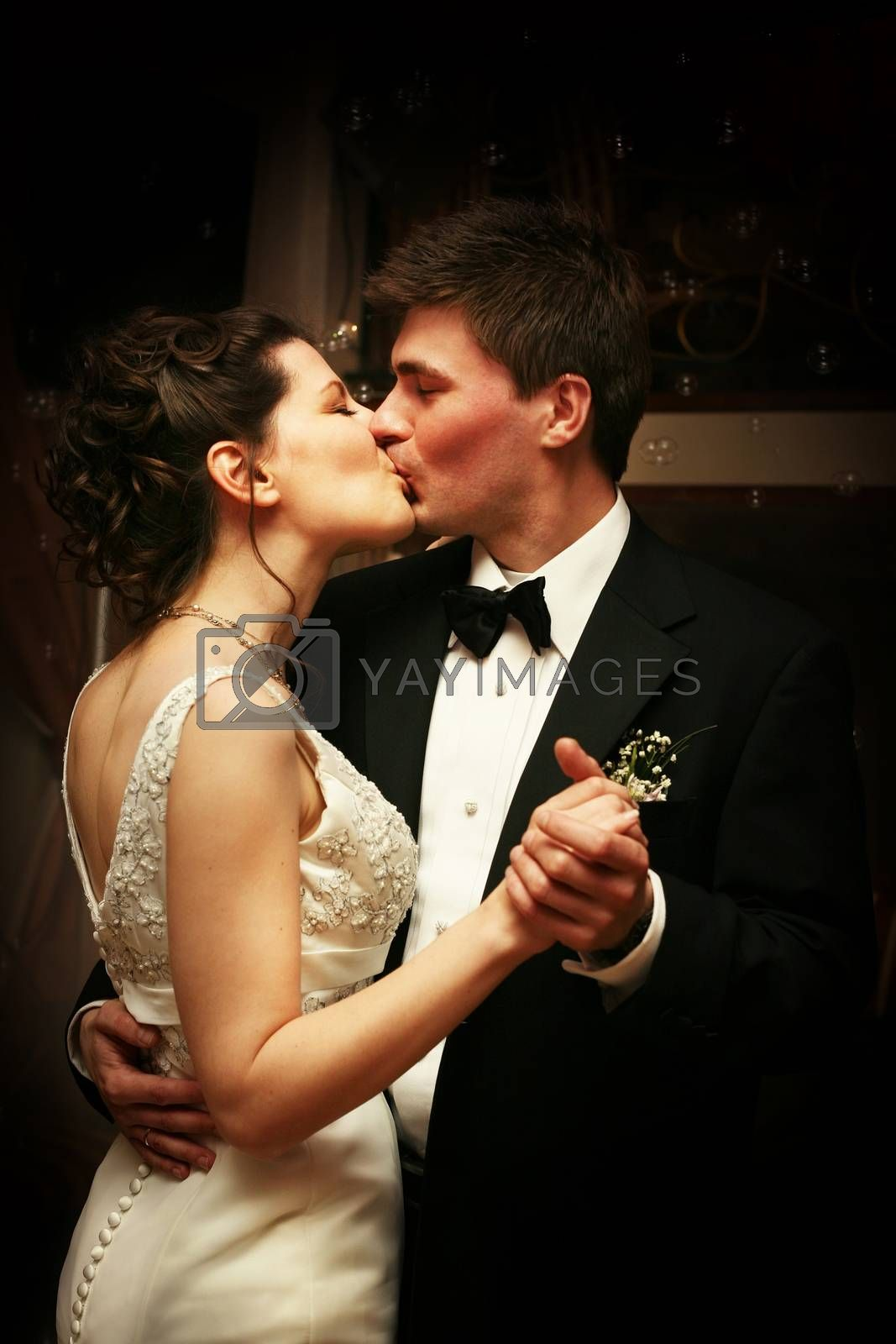 Romantic moment between bride and groom kissing celebrating their wedding day