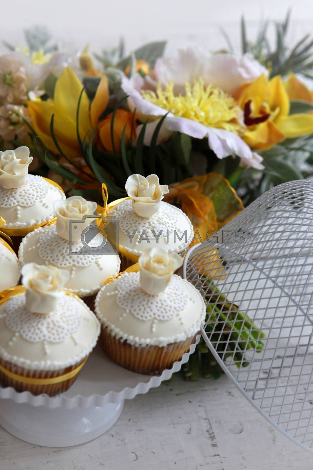 Royalty free image of Beautiful cakes and bridal bouquet in orange tones by friday