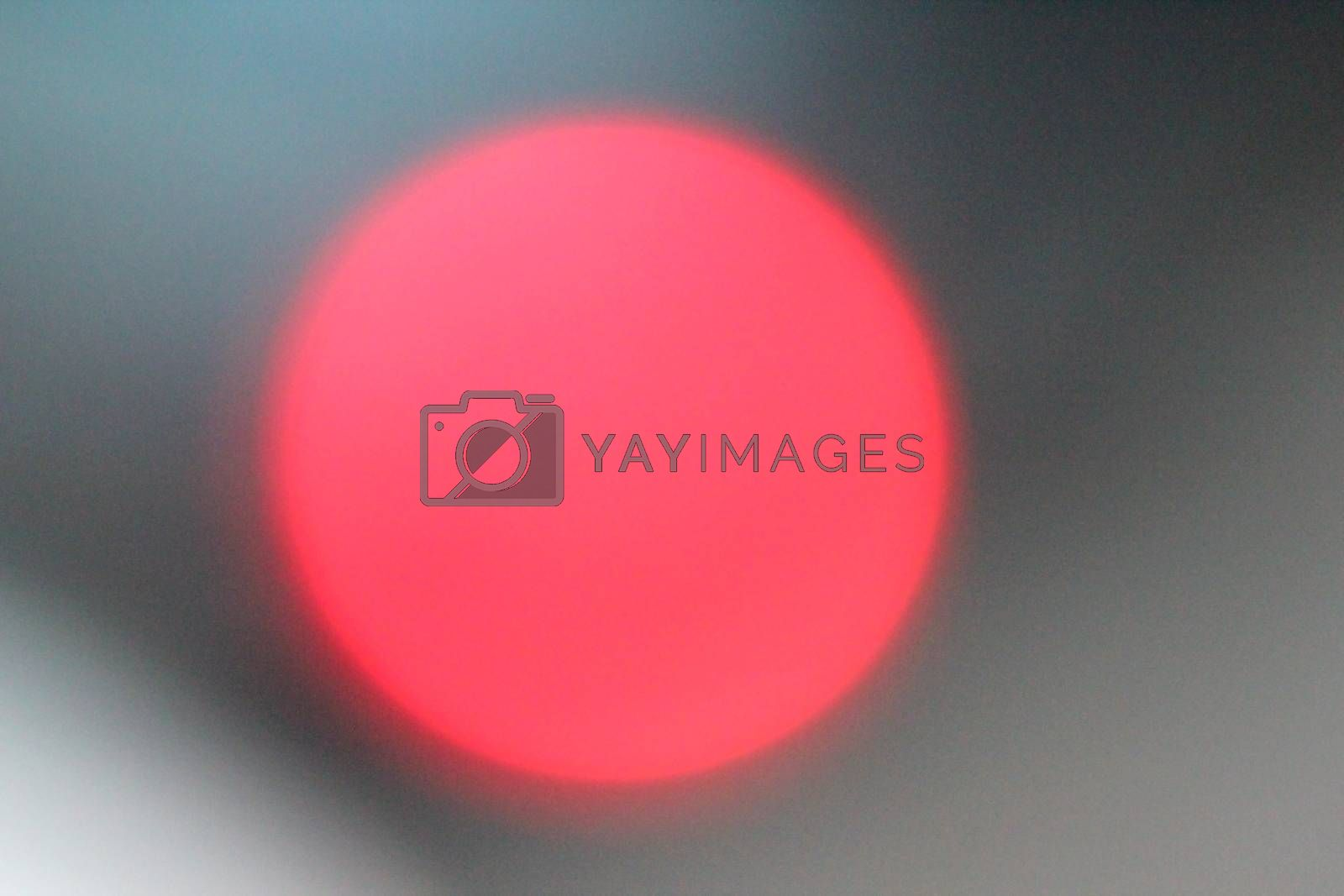 Defocused lights, red lens flare. Abstract blured background.