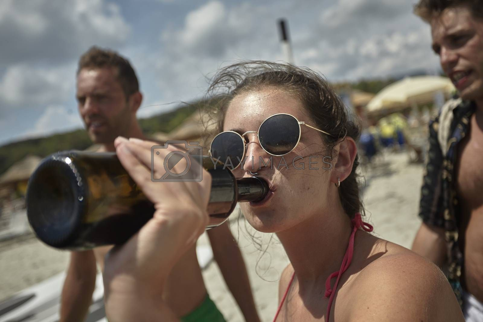 Young alcoholic girl drink from a bottle