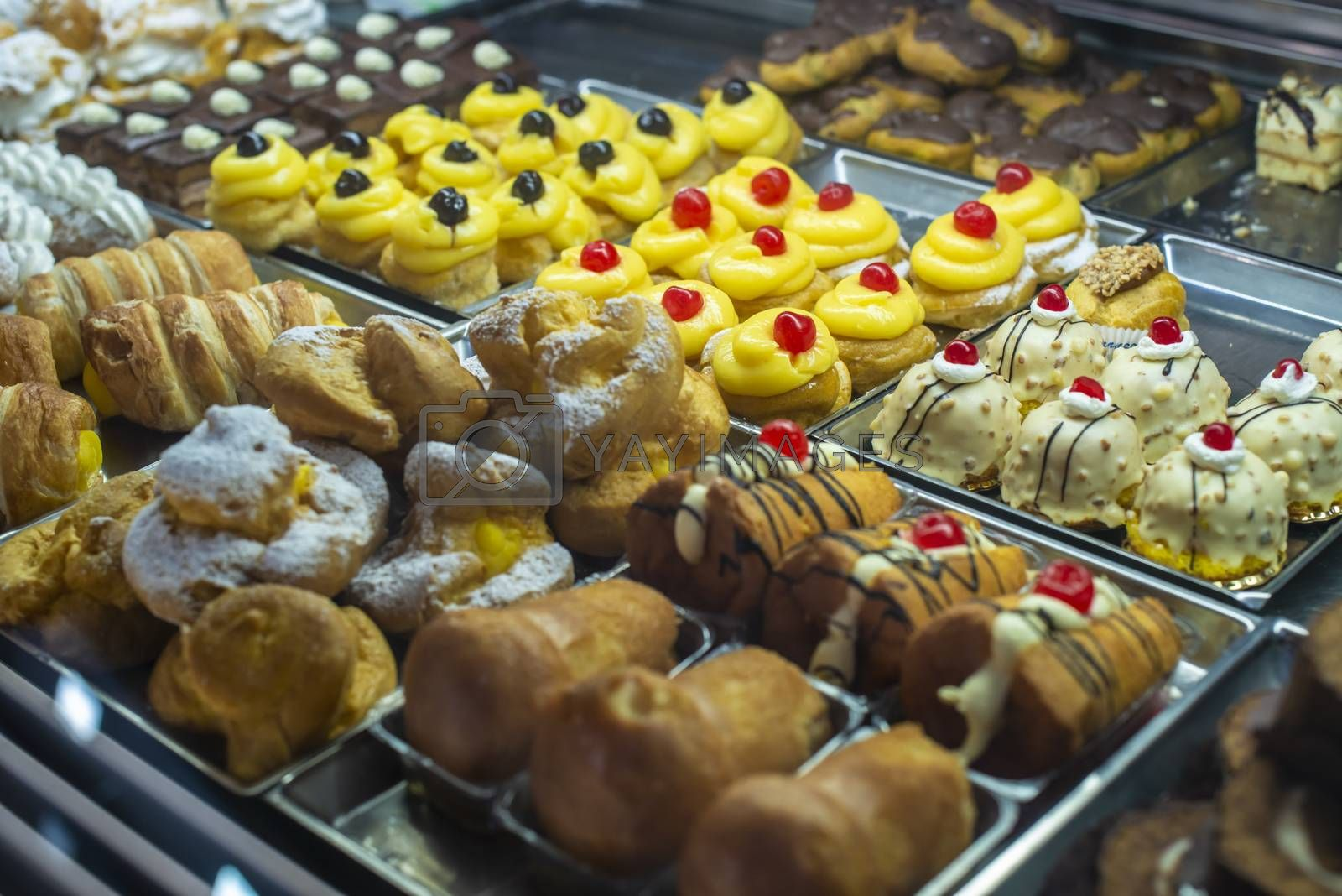 Italian pastry shop. Showcase on pastry shop. Cream and sweets.