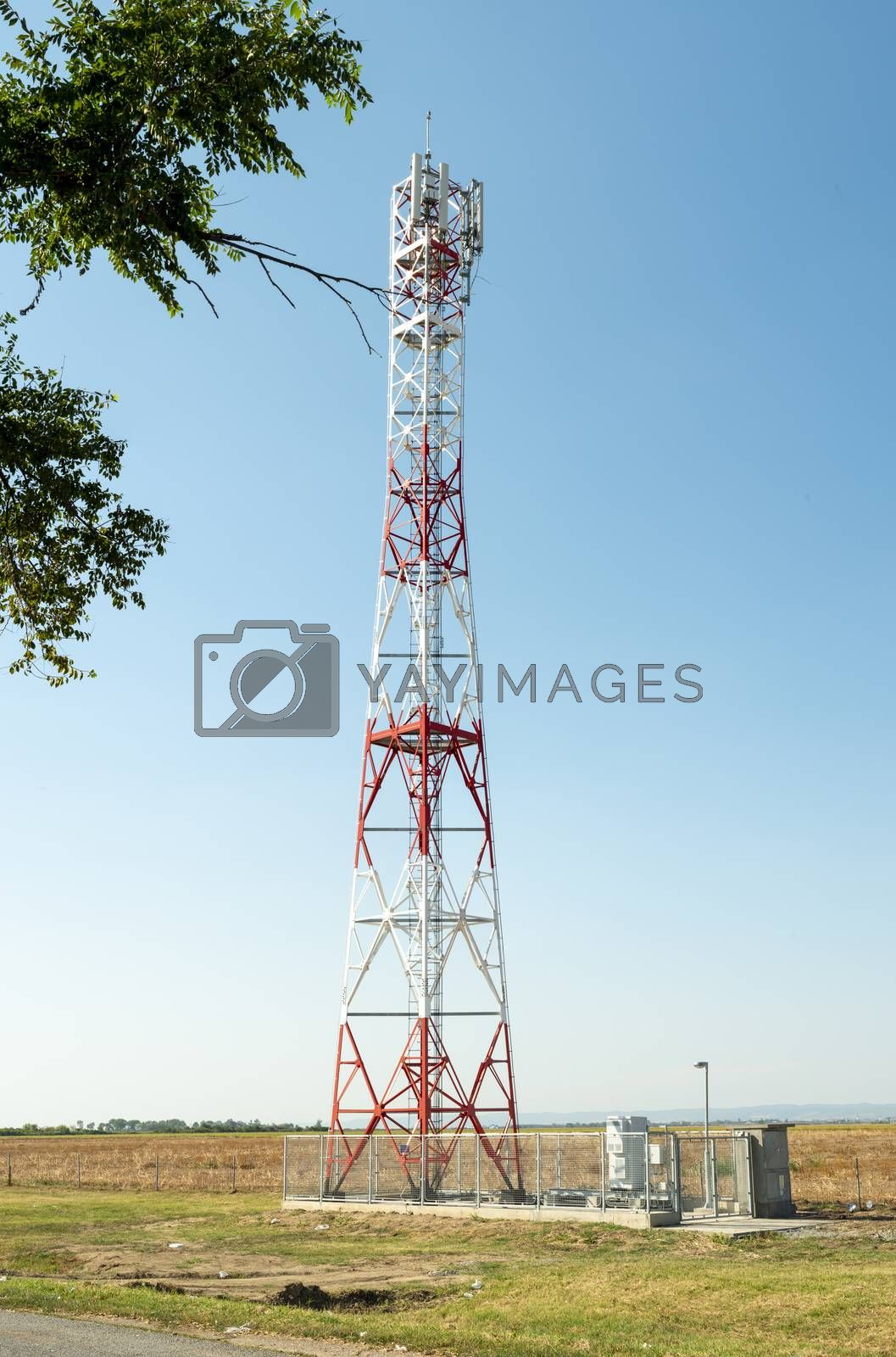 5G antenna for high speed internet distribution. 5G repeaters outside the city. Bright colours red and white.